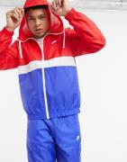 Nike Club woven tracksuit set in blue/red